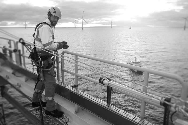engineer-surveying-offshore-wind-turbine