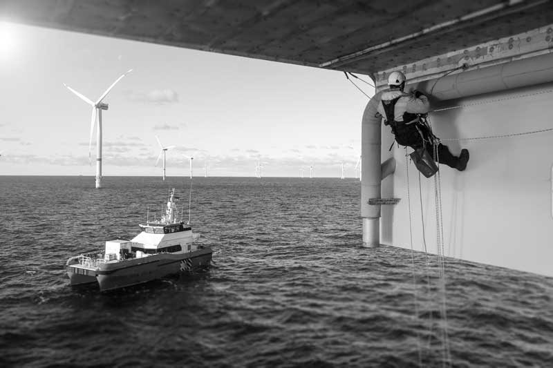 engineer-fixing-turbine-at-sea